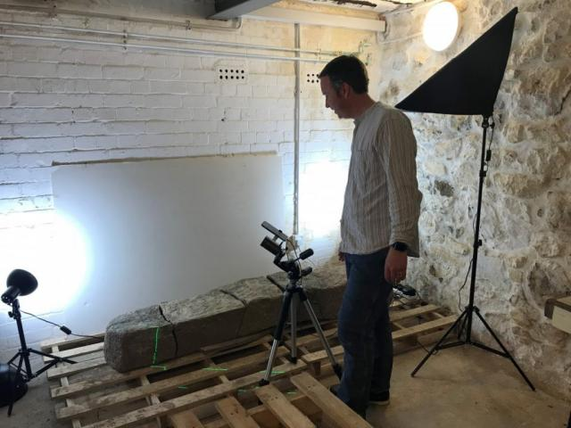 Archaeologist Tom Goskar carrying out close-range laser scanning on the stone.